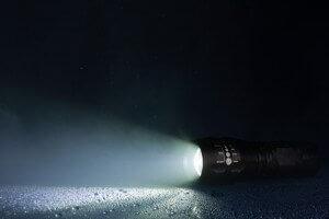 waterproof flashlight with waterdrops and smoke